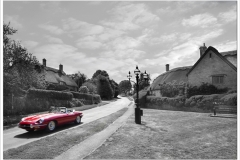 Cars in Chipping Campden ~ Jaguar E type arriving in Westington